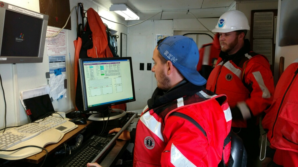 David Wells (CIGLR) and Paul Glyshaw (CIGLR) operating the MOCNESS. Photo Credit: Joann Cavaletto.