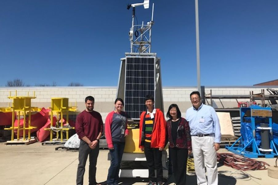 California High School student, Jason Wang and family, visits NOAA GLERL and CIGLR researchers to talk about his award winning science fair project and tour the NOAA GLERL facility. Photo Credit: Aubrey Lashaway.