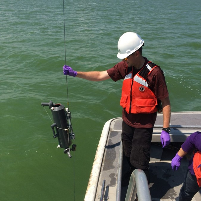 CIGLR Postdoctoral Associate Dr. Kevin Meyer completes Diel HABs sampling during a bloom event. He is collecting water samples, using Niskin Bottles, in Lake Erie to study the diurnal migration of Microcystis within the water column. Photo Credit: NOAA GLERL.